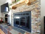 Rare, wood-burning fireplace and flat screen TV in living area