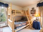 Bedroom 3 sleeps 4 with two bunk beds (twin over full and twin over twin), private full bathroom and deck access.