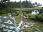 Salt Marsh and Estuary viewed right from the stone patio of Main House