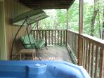 hot tub, swing on bottom deck and access to fire pit area.