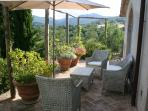 The outdoor breakfast terrace with stunning views of the valley.