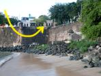 Another view of house  taken from pier below the wall.showing OLd City Wall  and beach below  house.