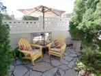 Your Private Patio with propane BBQ...Great for Kickin Back in the morning or after the beach.