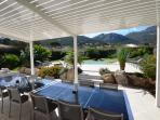 Shaded terrace with view over your swimming pool