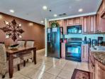Splash 1202 E kitchen with granite countertops and GE Profile appliances