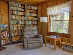 Sitting area (in master bedroom) has extensive library, including children's books.