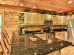 Granite counter tops - stainless steel appliances!  Gourmet Kitchen large enough for any group!