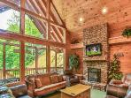 Huge Stacked Stone seasonal fireplace with large flat screen Tv and windows galore!