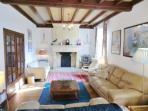 The large living-room, La Florette. TV receives UK programmes.  Many books, cassettes, DVDs. Wifi.