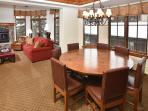 Some condos have a dining area with a round table.