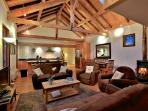 Spacious living area with log fire