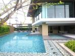 Out door swimming pool with fitness up-stairs.