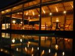 The bale looks spectacular at night, the lights reflecting in the infinity pool.
