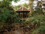 Impressions of the garden, hexagonal gazebo in one of the small ponds