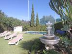 Nice garden with heated pool sunlounger to relax and enjoy your holiday