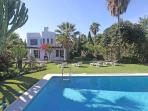 Villa in a tropical garden with heated pool and sunlounger to enjoy your holiday