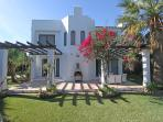 Front face from the Villa with hugh terrace and BBQ area