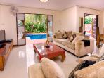 open plan house, dinning table, Tv  , Master bed room and room 4 open to the pool