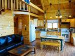 Open kitchen and living room area - Brassua Lake Log Cabin