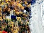 aerial view in fall of cabin on Brassua Lake