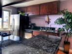 Stainless kitchen appliances with breakfast bar and gas stove