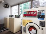 Coin laundry on the 7th floor of the building. 200 yen for a full laundry machine, 100 yen for  dry