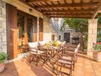 Covered terrace with outdoor dining area