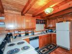 Kitchen has everything you need to cook and serve a full meal