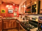 Newly remodeled kitchen with full amenities including oven, dishwasher, coffee maker, blender, toast