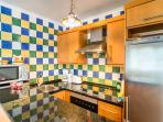 The recently refurbished kitchen houses modern appliances