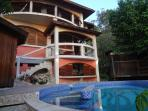 Front view of villa from the pool. Owner/artist/designer built.