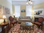 Hardwood floors, high ceilings,  decorative hearths, and original pocket doors are classic features of a historic...