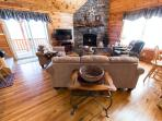 Floor to ceiling stacked stone fireplace welcomes you home after days of adventures.