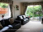 sitting room with french windows leading to private patio with garden furniture sun-bathing ideal!