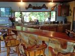 Wet Bar/ Kitchen overlooking our Gardens, Ponds and Lake Arenal. Nature at it's best!