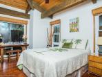 Guest bedroom suite with slab wood desk. Queen bed