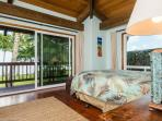 Master bedroom suite with water views and lanai access.