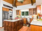 Fully equipped gourmet kitchen with island range.