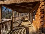 main floor deck with rocking chairs to catch up with family