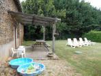 Gite Patio with garden sun beds, pool.