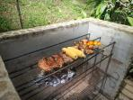Outdoor barbeque pit with sink. An experience we highly recommend.
