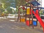 children´s playground, basketball / football field, behind the building
