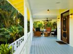 Take a moment to sit down and relax on the magnificent wraparound lanai (porch).
