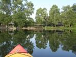 View of Waterside Cottage, gazebo and spillway from kayak