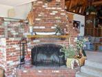 Custom brick fireplace in heart of cottage