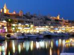Benalmadina by night, hive of activity, restaurants, bars, shops, stalls, boat rides, cruises.