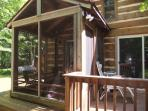 Back of cabin with private porch and wrap around deck area