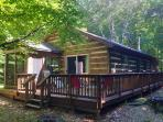 Wrap around deck with private screened porch, bedrooms 1 and 2
