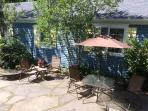 Exclusive use patio area has table, 4 chairs, umbrella, and gas grill, 2 lounges. Flowers too.