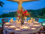 Silent Waters Villa dining gazebo with view of Montego Bay at dusk